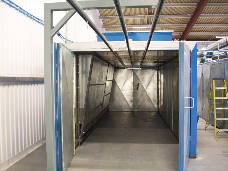 Curing oven with track system